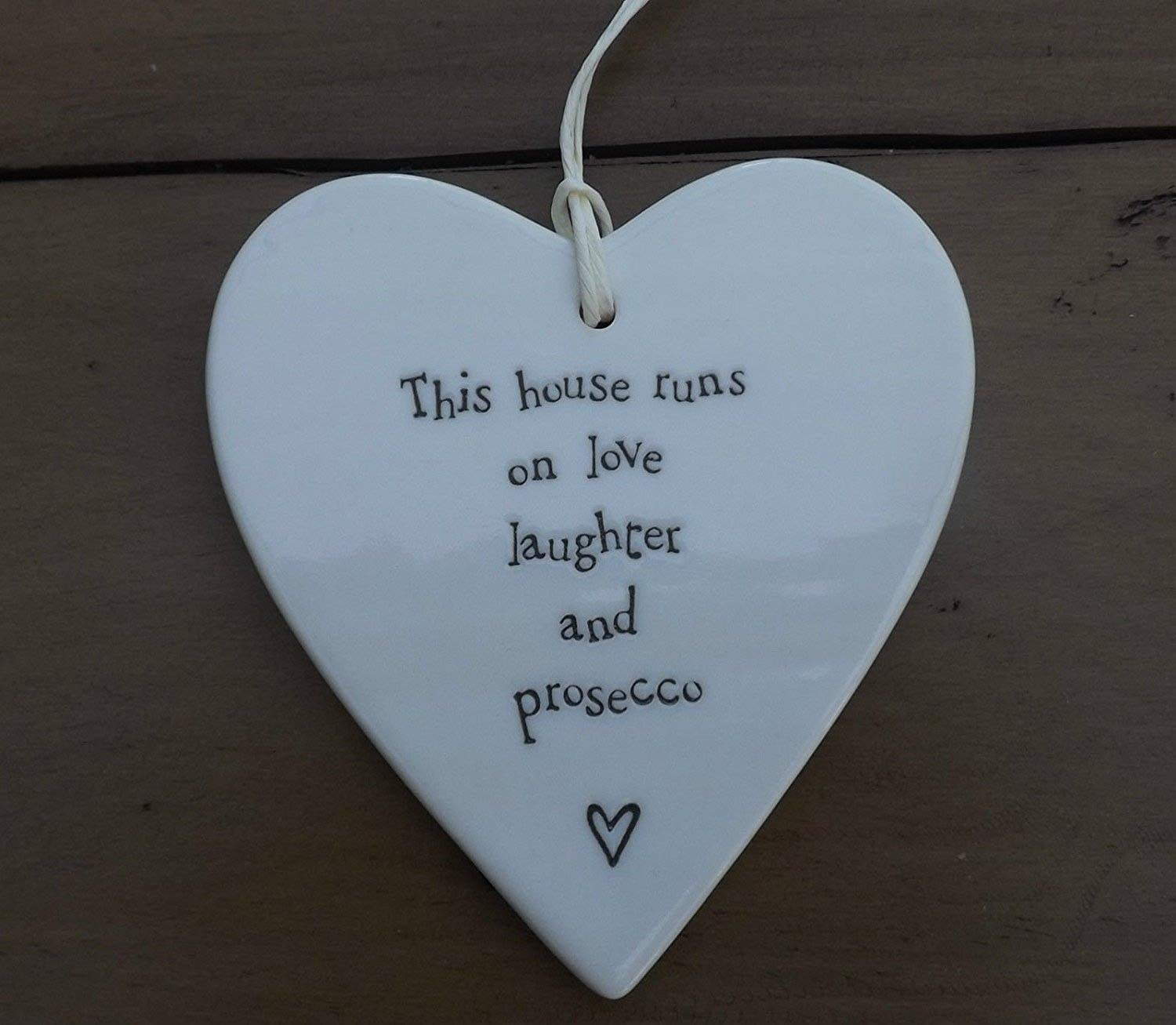 East of India Rounded Porcelain Heart 'This house runs on....