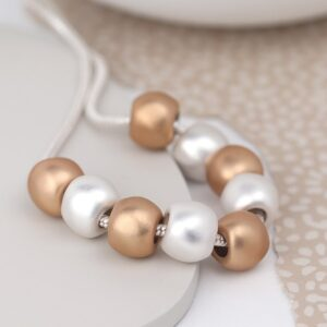 Silver and rose gold plated worn bead necklace