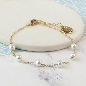 Gold plated chain and white faux pearl bracelet