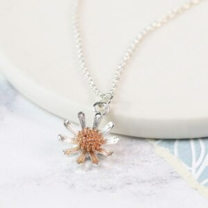 Silver plated daisy necklace with rose gold detail