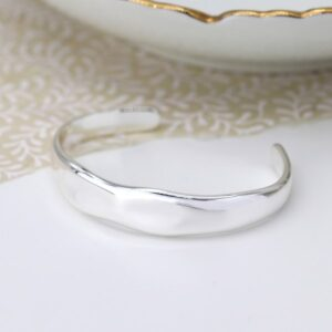 Silver plated open bangle with chic irregular edges